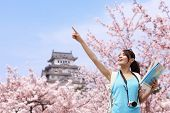foto of sakura  - Happy woman traveler enjoy view with sakura cherry blossoms tree and castle on vacation while spring in japan asian - JPG