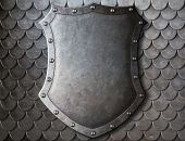 pic of coat  - old medieval coat of arms shield over scales armour background - JPG