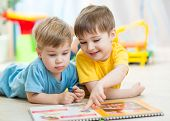 pic of little kids  - kids brothers read a book at home or nursery - JPG