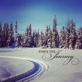 foto of blanket snow  - scenic instagram of snowmobile tracks in snow on a bright day with quote - JPG