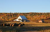 image of hay bale  - Rural farmland with silver barn and hay bales with an autumn scenic background in New Brunswick Canada - JPG