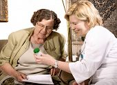 pic of nurse practitioner  - Senior woman is visited by her doctor or caregiver at home - JPG