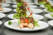 stock photo of tiger prawn  - Tiger shrimp prawns with fresh lettuce in plate - JPG