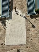 foto of sundial  - ancient sundial on a building in the historic center of Urbino - JPG