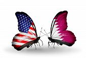 stock photo of qatar  - Two butterflies with flags on wings as symbol of relations USA and Qatar - JPG