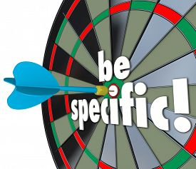 picture of objectives  - Be Specific 3d words on a dart board to target precise directions and defined goals or objectives for a job - JPG