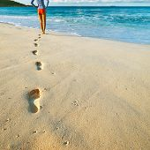 picture of footprints sand  - Woman at beautiful beach at Seychelles walking on sand - JPG