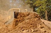 pic of bulldozers  - Large bulldozer moving rock and soil for fill for a new commercial development road construction project - JPG