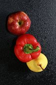 image of yellow-pepper  - macro yellow pear red apple and red bell peppers on black background studio - JPG