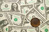 stock photo of hasp  - A lot of banknotes one US dollar and old button - JPG