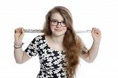 foto of flute  - blond teenage girl wearing glasses holds flute in studio against white background - JPG