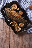 picture of grill  - Grilled carp with lemon in a grill pan vertical view from above closeup - JPG