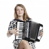 image of accordion  - teenage girl sits in studio with accordion against white background - JPG