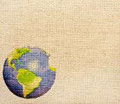 stock photo of canvas  - Grunge background with abstract world map printed on canvas texture - JPG