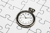stock photo of jigsaw  - Clock on jigsaw Jigsaw and puzzles concepts - JPG