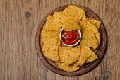 picture of nachos  - Fresh salsa dip with nachos chips on wooden background top view - JPG