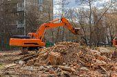 image of power-shovel  - crawler excavator removes construction waste after building demolition - JPG
