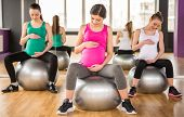 stock photo of pregnancy exercises  - Fitness sport and lifestyle concept  - JPG