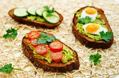 image of tomato sandwich  - rye sandwiches and mashed avocado eggs tomatoes and cucumbers - JPG