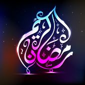 stock photo of ramadan calligraphy  - Glossy arabic calligraphy text Ramazan Kareem on shiny colorful background for holy month of muslim community - JPG