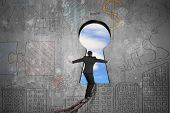 stock photo of keyholes  - Businessman balancing on old iron chain toward keyhole door with sky clouds view and business concept doodles wall background - JPG
