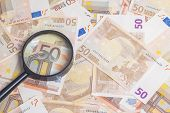 pic of fifties  - Closeup of fifty euro notes through magnifer background - JPG
