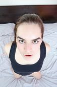 pic of genital  - Girl with shocked face expression with close approache staring with wide eyes open to camera - JPG