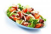 stock photo of smoked ham  - Smoked ham and vegetables on white background - JPG