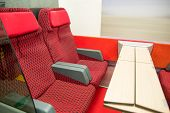 picture of railroad car  - red modern seats of a railroad car - JPG