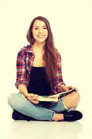 stock photo of crossed legs  - Woman sitting cross - JPG