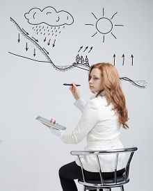 stock photo of transpiration  - Young woman drawing schematic representation of the water cycle in nature - JPG