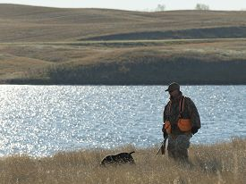 stock photo of hunter  - A hunter and his dog out on the prairie - JPG