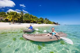 pic of kayak  - Family og mother and daughter paddling on kayaks at tropical ocean water during summer vacation - JPG