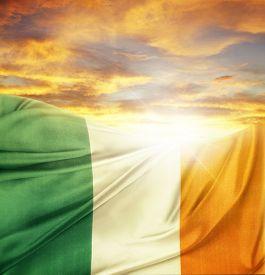 stock photo of irish  - Irish flag in front of bright sky - JPG
