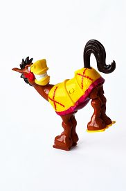 foto of wild donkey  - Leaping colorful donkey toy on the white background - JPG