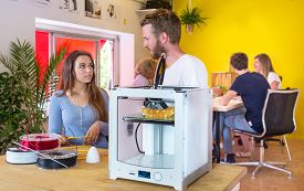 stock photo of coil  - Designers standing behind a 3D printer - JPG