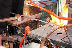 foto of anvil  - Blacksmith workshop with anvil and fire taken closeup - JPG