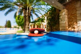 picture of ping pong  - Table tennis rackets and ping pong ball on the vacation place background at the summer time - JPG