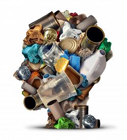 image of waste reduction  - Recycling ideas and environmental garbage management solutions and creative ways to reuse waste as old paper glass metal and plastic bottles shaped as a human head as a symbol for reusable thinking and conservation advice - JPG