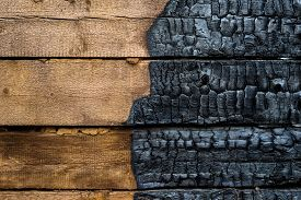 picture of half  - Half charred wooden wall of the house contrast - JPG
