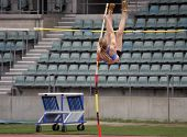 image of pole-vault  - female pole vaulter about to clear the bar - JPG
