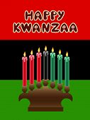 pic of unity candle  - kwanzaa kinara with The Black Liberation Flag as backdrop - JPG