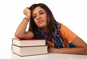 stock photo of droopy  - Middle eastern student in an uninterested attitude towards her books - JPG