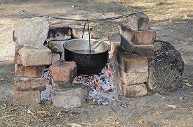 foto of cauldron  - Cooking at the picnic  - JPG