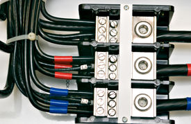 pic of electrical engineering  - close up shot of an electrical panel wiring with color coded cables - JPG