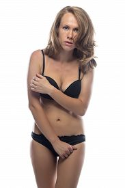 picture of shy woman  - Shy woman in black lingerie on white background - JPG
