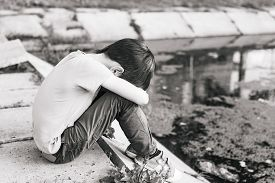 foto of weeping  - lonely sad boy dropped his head on his chest and weeping hid his face - JPG