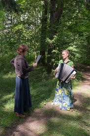 image of accordion  - two girls rehearsed performance with an accordion - JPG