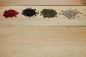 stock photo of red hot chilli peppers  - mixture of peppers hot pepper red pepper black pepper white pepper green pepper - JPG