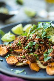 image of potato-field  - Sweet potato chips with spicy ground turkey nachos and guacamole